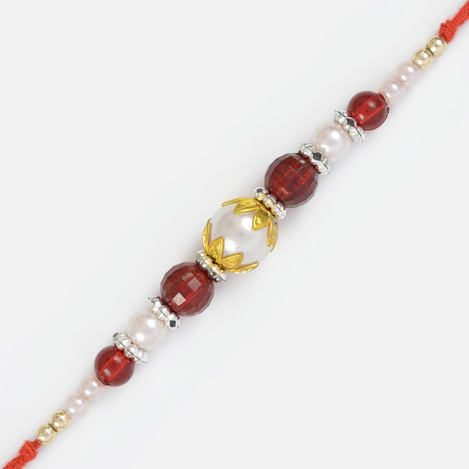 Pearl and Red Glass Beads in Golden Leafy Designs Fancy Rakhi