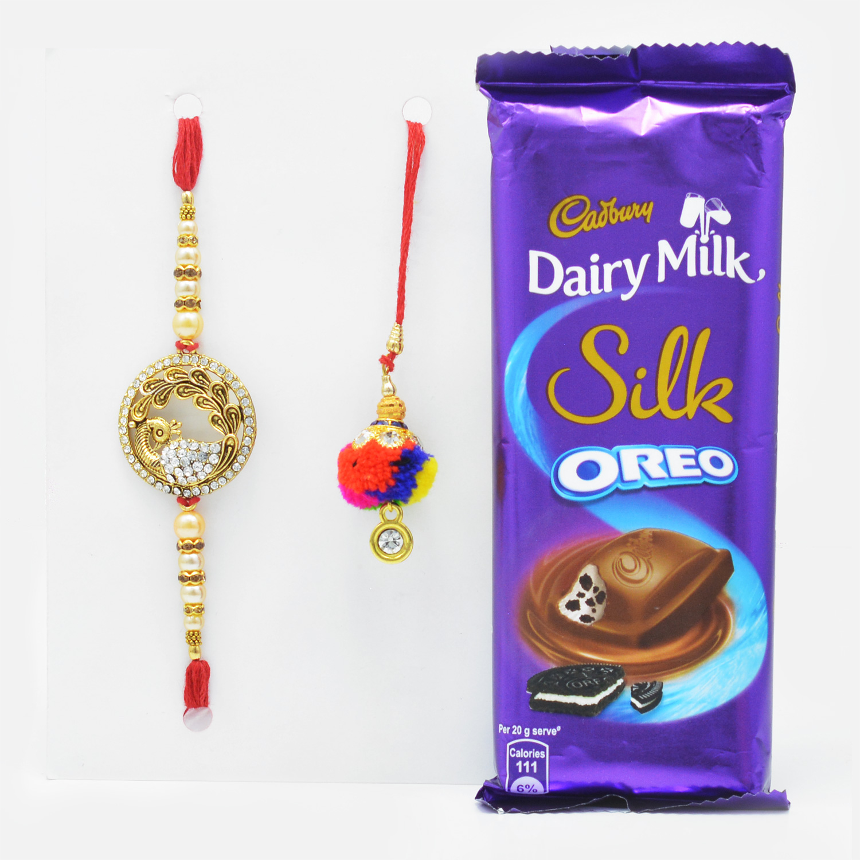 Golden Peacock Rakhi Set for Bhaiya-Bhabhi with Mouth-Watering Cadbury Dairy Milk Silk Oreo