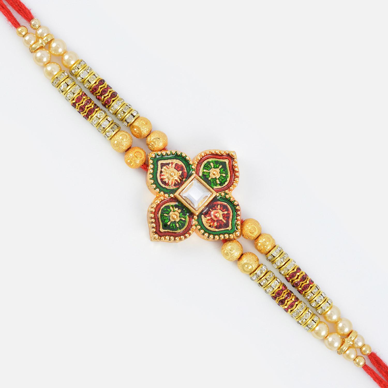 Beautiful Colored Four Ace Designed Golden Work Rakhi