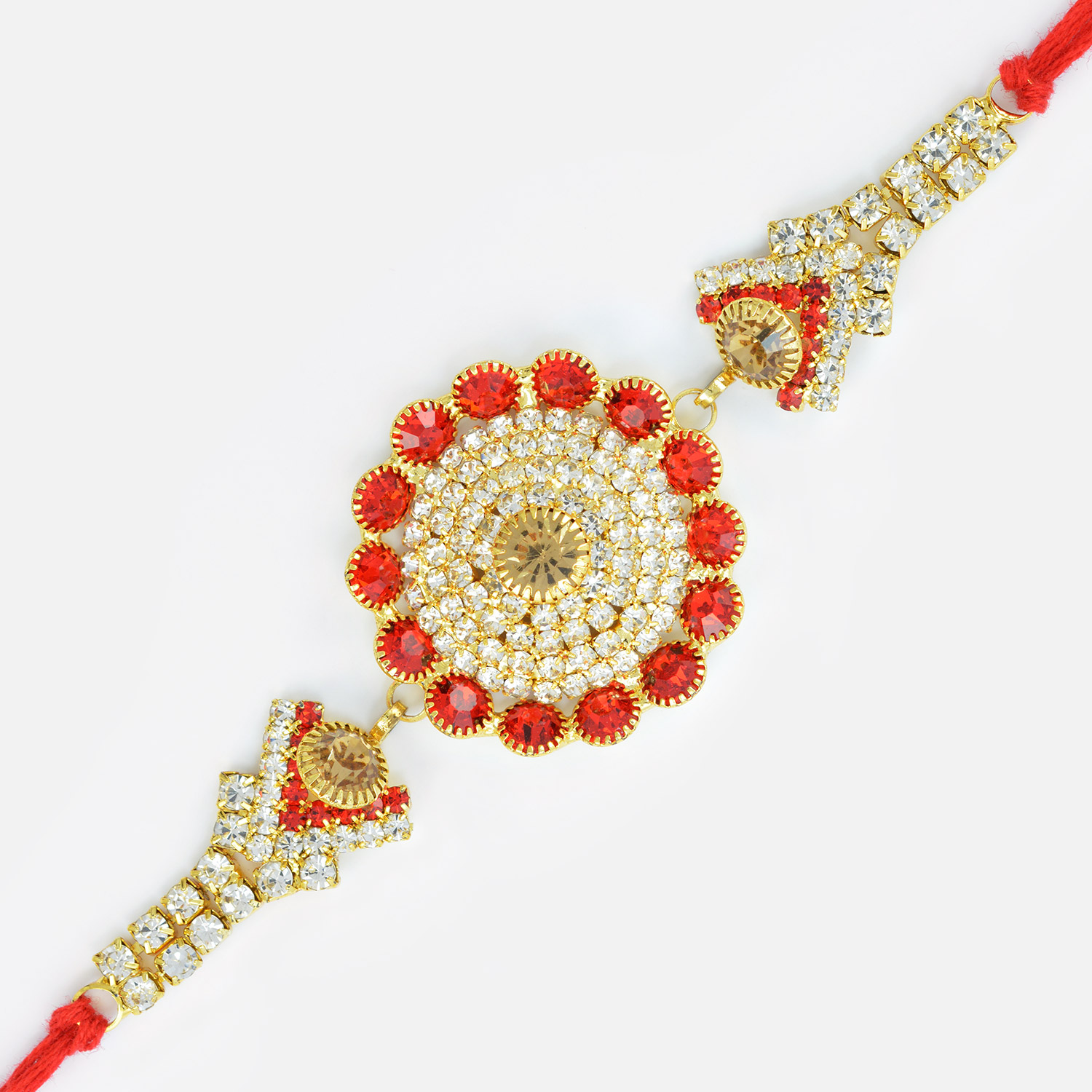 Royal look of Floral Shape Rakhi with Studded Diamonds and Jewels