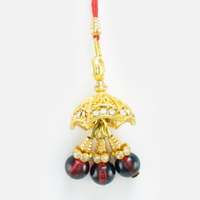 Maroon Ruby Golden Diamond Design Lumba Rakhi for Bhabhi