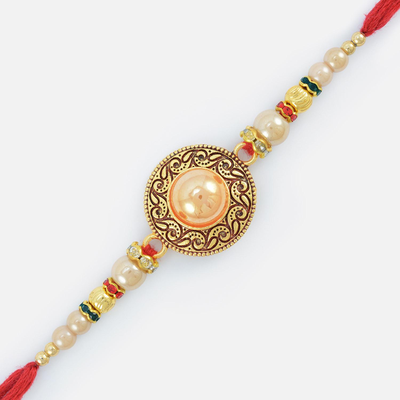 Fine Work Golden Designed Embossed Pearl Rakhi