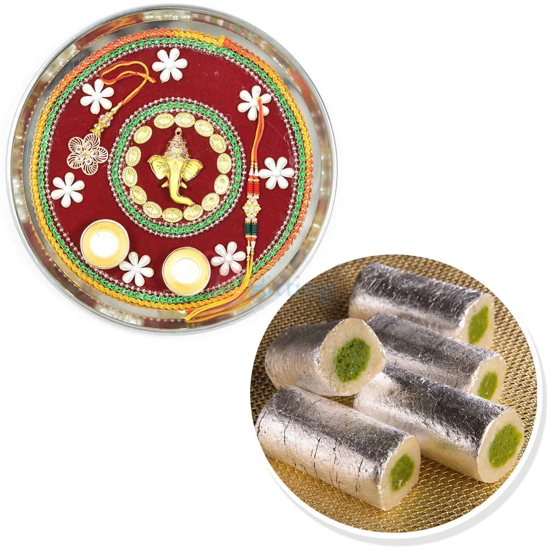 Fresh Kaju Roll Sweets and Designer Ganesha Rakhi Thali Hamper