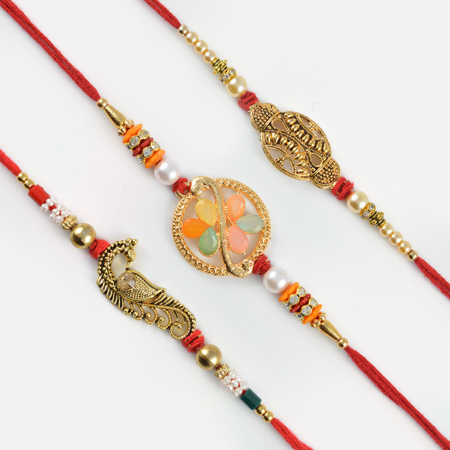 Astonishing Golden Mayur and Colourful Beads Rakhi Set of 3