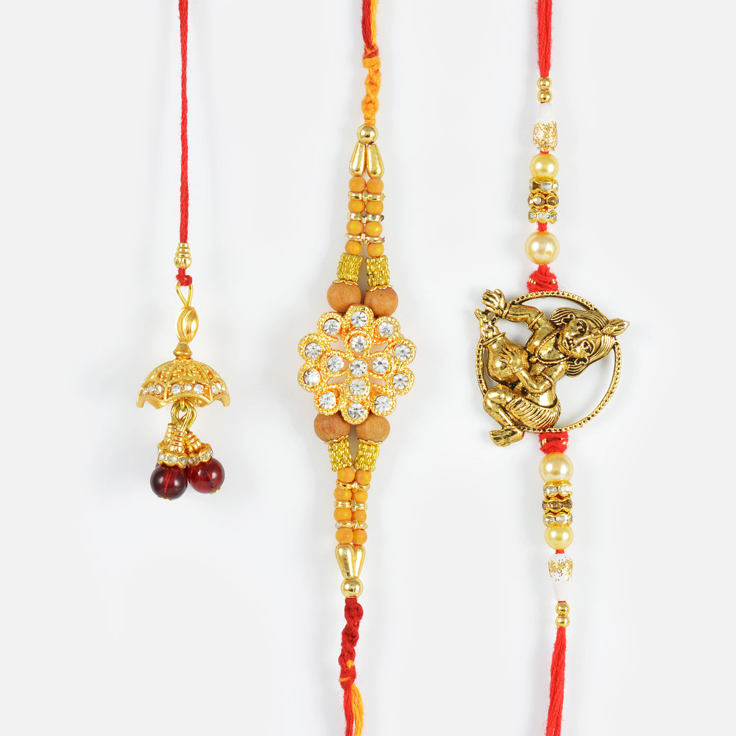Diamond Studded Rakhi Set with Red Pearl Lumba Rakhi Set of 3