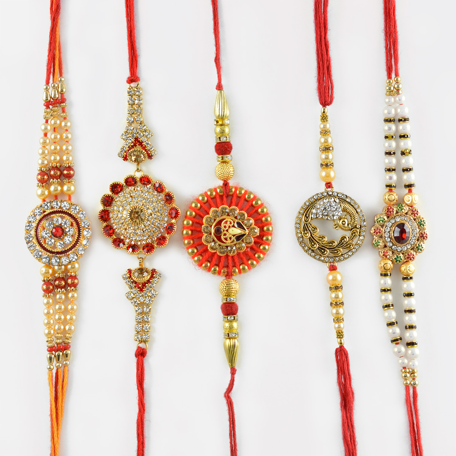 Classy Diamond Studded Peacock Feathers Diamond Rakhi Set