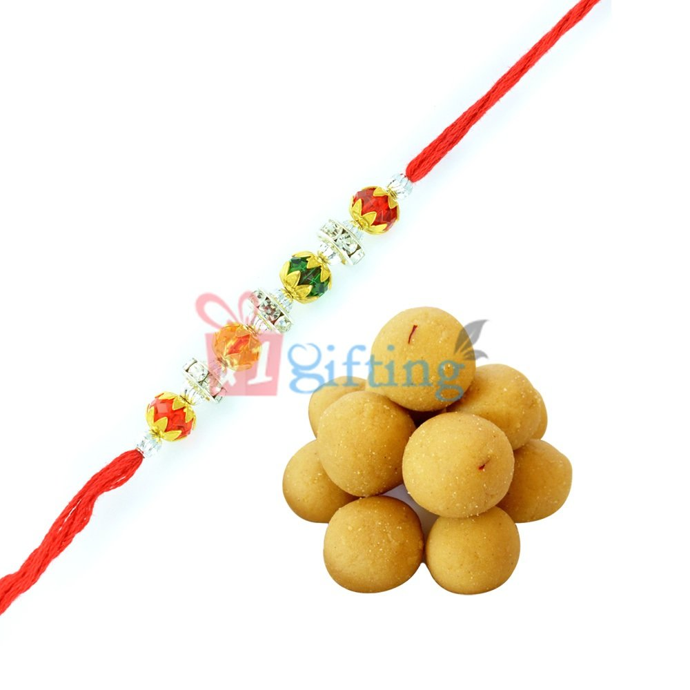 Stupendous Diamond Rakhi for Brother with Besan Laddu Sweets