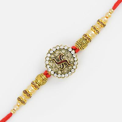 Floral Shape Swastik Rakhi with Golden Beads and Diamonds