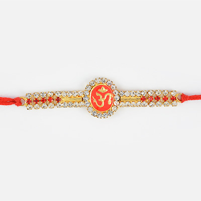 Floral Shape OM Rakhi with Silver and Red Diamonds Work