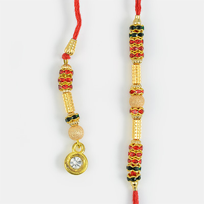 Golden Pipes with Zigzag Diamonds Pair of Rakhi