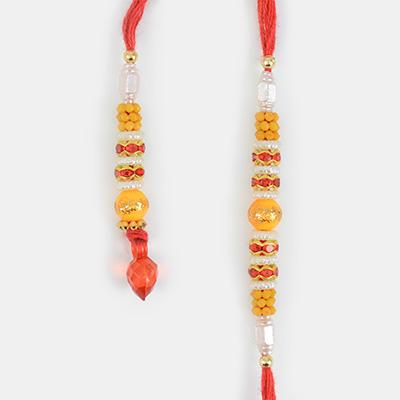 Nice-looking Pearl and Red Diamond with Mauli Pair of Rakhi