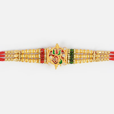 Beautiful Om Rakhi with sandalwood and Red and Green Beads