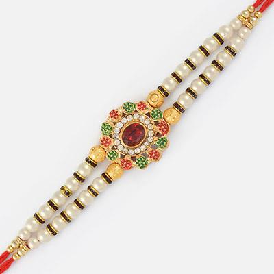 Graceful Design Central Red Stone Golden Rakhi