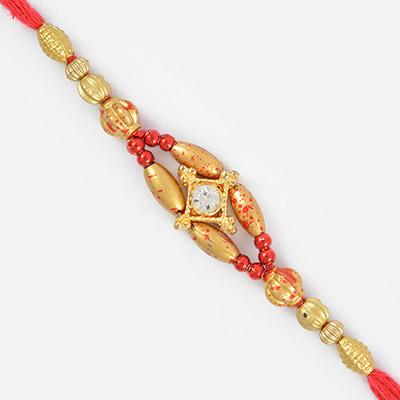 Alluring Diamond Rakhi in Golden Beads