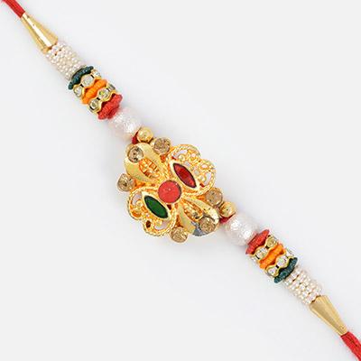 Central Red Bead Golden Design Rakhi with Multi-Colred Gems