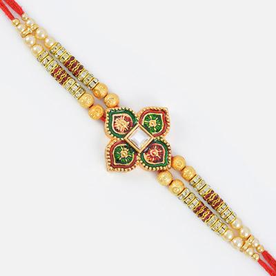 Beutiful Colored Four Ace Designed Golden Work Rakhi
