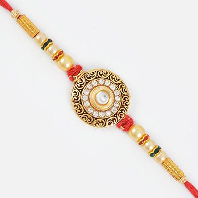 Decorative Mani Diamond Rich Centered Designer Rakhi with Golden Pearl