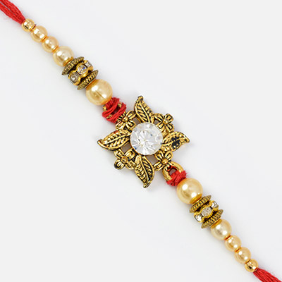 Central Studded Diamonds on Leaves with Golden Pearl Rakhi