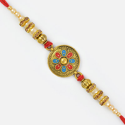 Magnificent Beauty of Golden Coin and Pearl Beaded Mauli Rakhi
