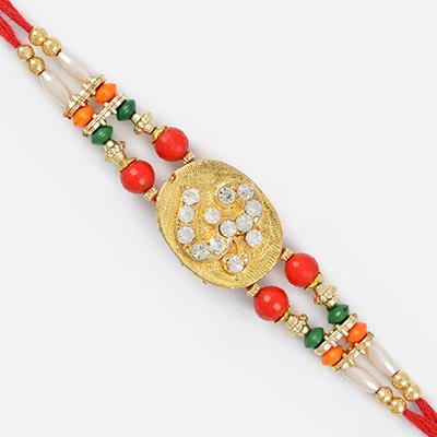 Golden Base Diamond Om Rakhi with Designer Color Beads