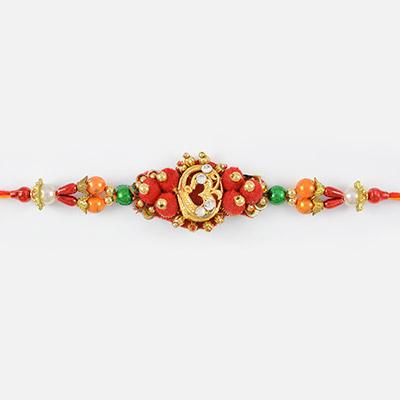 Golden OM Auspicious Designer Rakhi with Red and Golden Beads