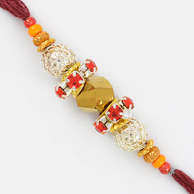 Double Red Diamonds Ring with Golden and Silver Designer Beads Rakhi