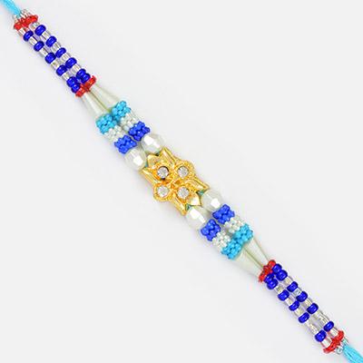 Beautiful Golden Flower Diamond Blue Color Fancy Rakhi