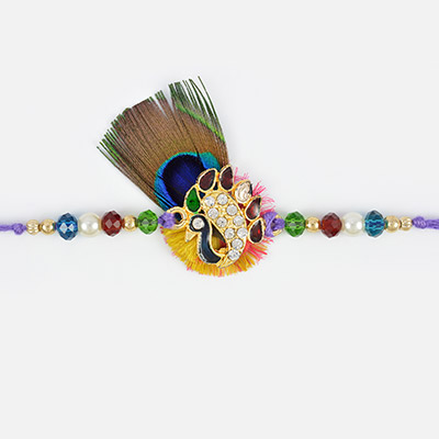 Amazing art of kundan and pearl with beads in peacock fancy Rakhi