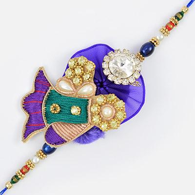 Exclusive designer diamond Rakhi with marrow of beads in blue fancy Rakhi