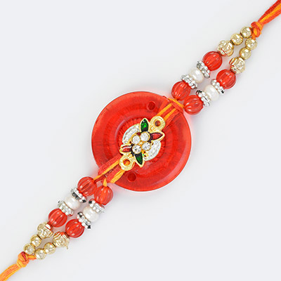 Magnificent Beauty of Golden Glass and Pearl Beaded Fancy Mauli Rakhi