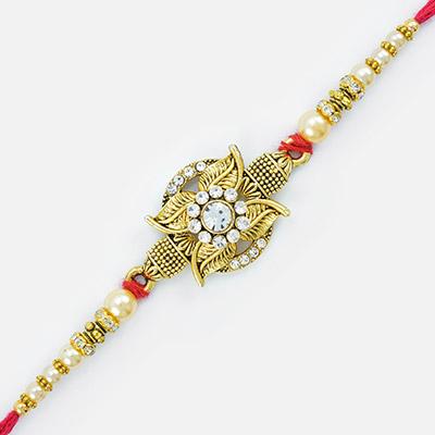 Magical Sparkling Diamonds Work with Golden Leaves Base Rakhi