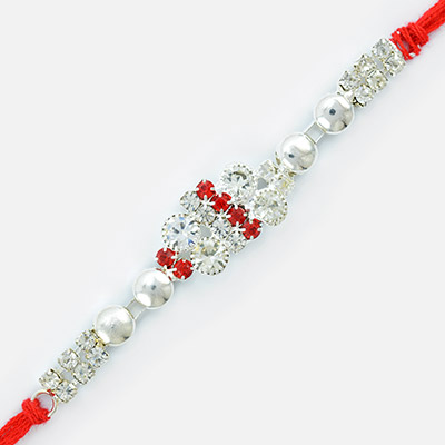 Magnficently Designed Pearl and Jewel Linear Rakhi