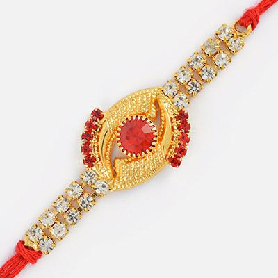 Golden Eye Look Rakhi with Central Studded Red Diamond