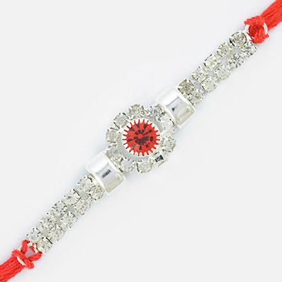 White Diamond Base Central Red Diamond Studded Linear Rakhi