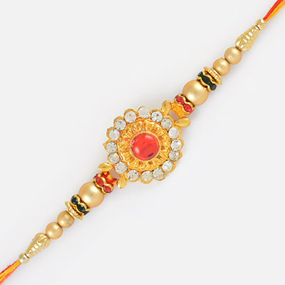 Floral Type Golden Rakhi with Pearl and Matalic Diamond