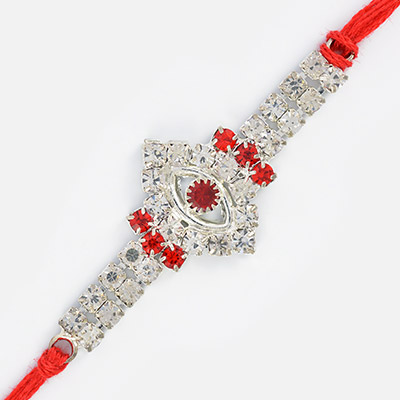 Oval Shaped Central Studded Red diamond Jewel Rakhi