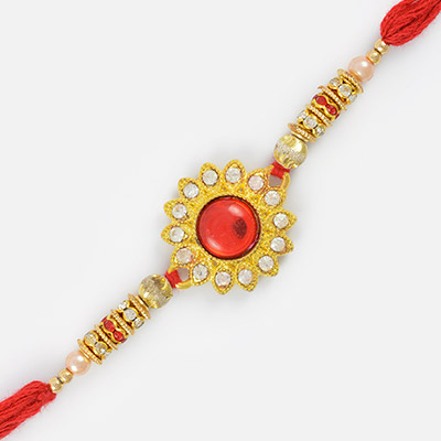 Floral Designed Golden Base Moli Rakhi with Kundan Stones