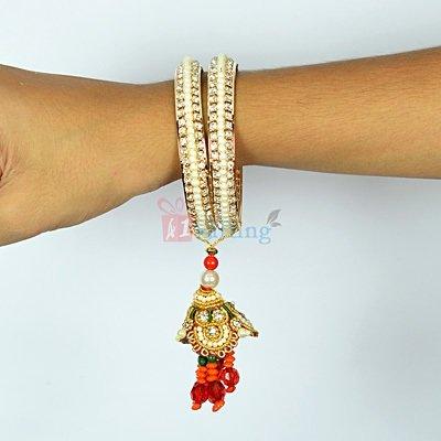 Special Pearl and Diamond Lumba Rakhi with Zardozi Work
