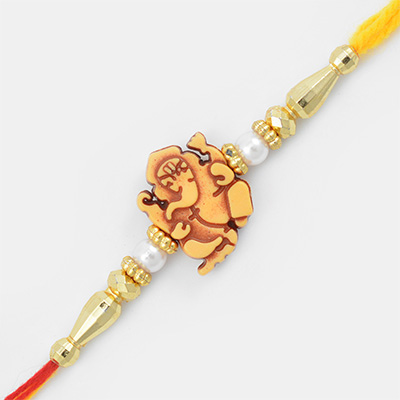 Brown shaded Central Lord Ganesha Mauli Rakhi with White Pearl and Beads