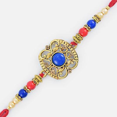 Superb Red and Blue Stone Golden Base Rakhi