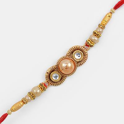 Wondrous Two Studded Diamond with Central Pearl Rakhi