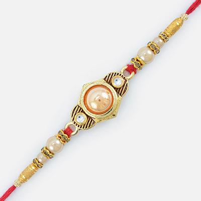 Hexa Shape Golden Studded Diamond Designed Pearl Rakhi
