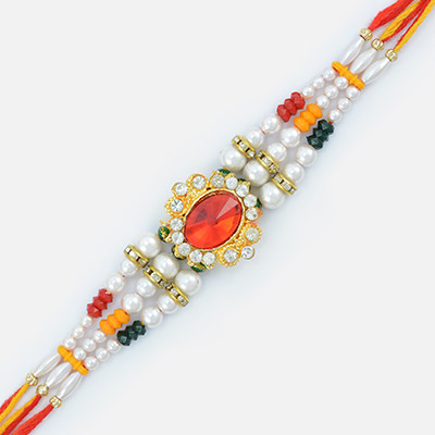 Pearl Emphasized with ruby and beads Rakhi for Brother