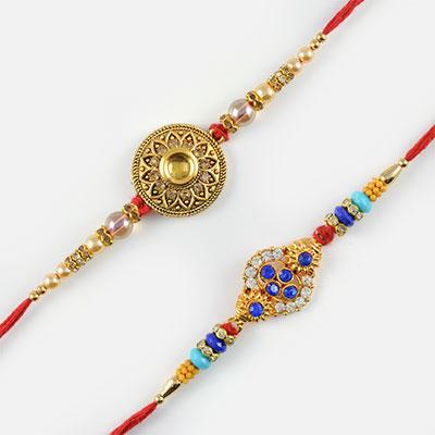 Splendid Gold, Silver, Blue Diamond Rakhi Set