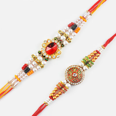 Awesome Red Diamond and Pearl Rakhi Set of 2