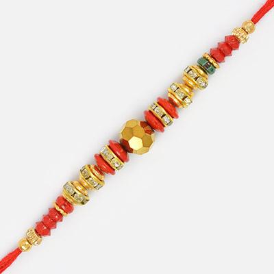 Golden Cutting Bead with Gems and Diamond Rakhi