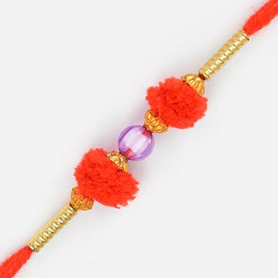Central Red Bead Golden Design Thread Rakhi